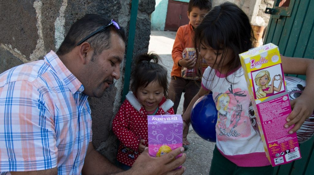 As part of his annual toy drive, Camaron hands out toys to children in the rural village of La Caja, just outside Irapuato.