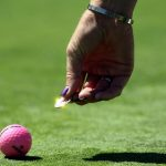 Marking ball on green
