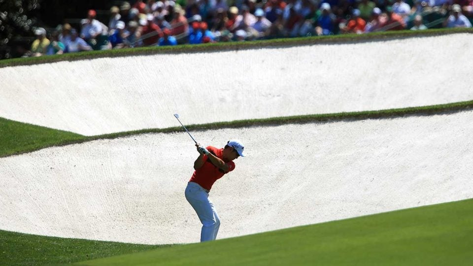 Hideki Matsuyama plays the 5th hole during the Masters at Augusta National.