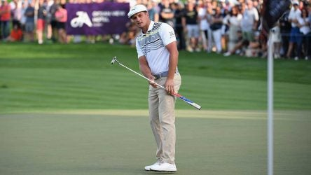 Bryson DeChambeau putts with the pin in during the Omega Dubai Desert Classic.