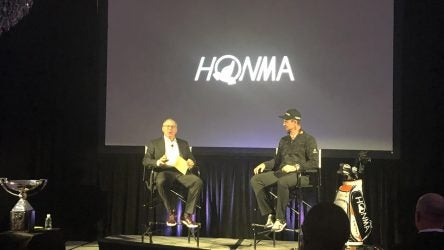 Honma's Mark King and Justin Rose