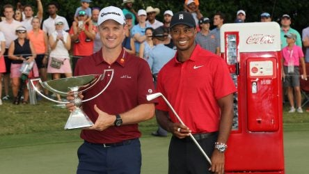 Justin Rose and Tiger Woods pose after tje 2018 Tour Championship.