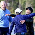 Lydia Ko hugs Eun-Hee Ji as former MLB pitcher John Smoltz looks on at the Diamond Resorts Tournament of Champions on Sunday.