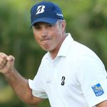 Matt Kuchar pumps his fist after making a birdie putt on the 15th hole during the final round of the Sony Open on Sunday.