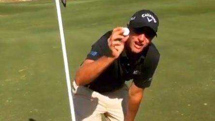 Nicolas Colsaerts shows off his golf ball after making a hole-in-one on a par-4.