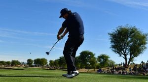 Phil Mickelson tees off during the third round of the Desert Classic.