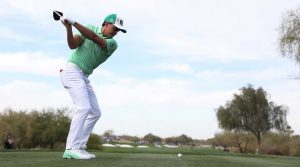 Rickie Fowler tees off during the first round of the 2019 Waste Management Phoenix Open.