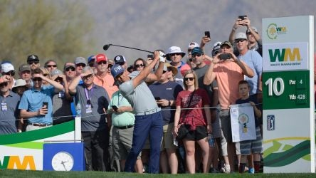Rickie Fowler tees off during the 2019 Waste Management Phoenix Open