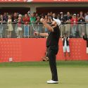 Shane Lowry raises his arms after making birdie to win the Abu Dhabi HSBC Championship.