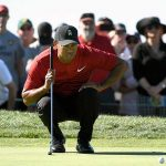 Tiger Woods reads a putt during the 2018 Farmers Insurance Open.