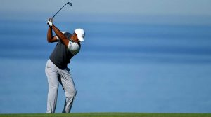 Tiger Woods hits an approach during the first round of the Farmers Insurance Open.