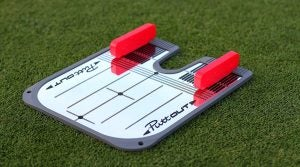 The puttOut Training aid improves golfers' alignment on the greens