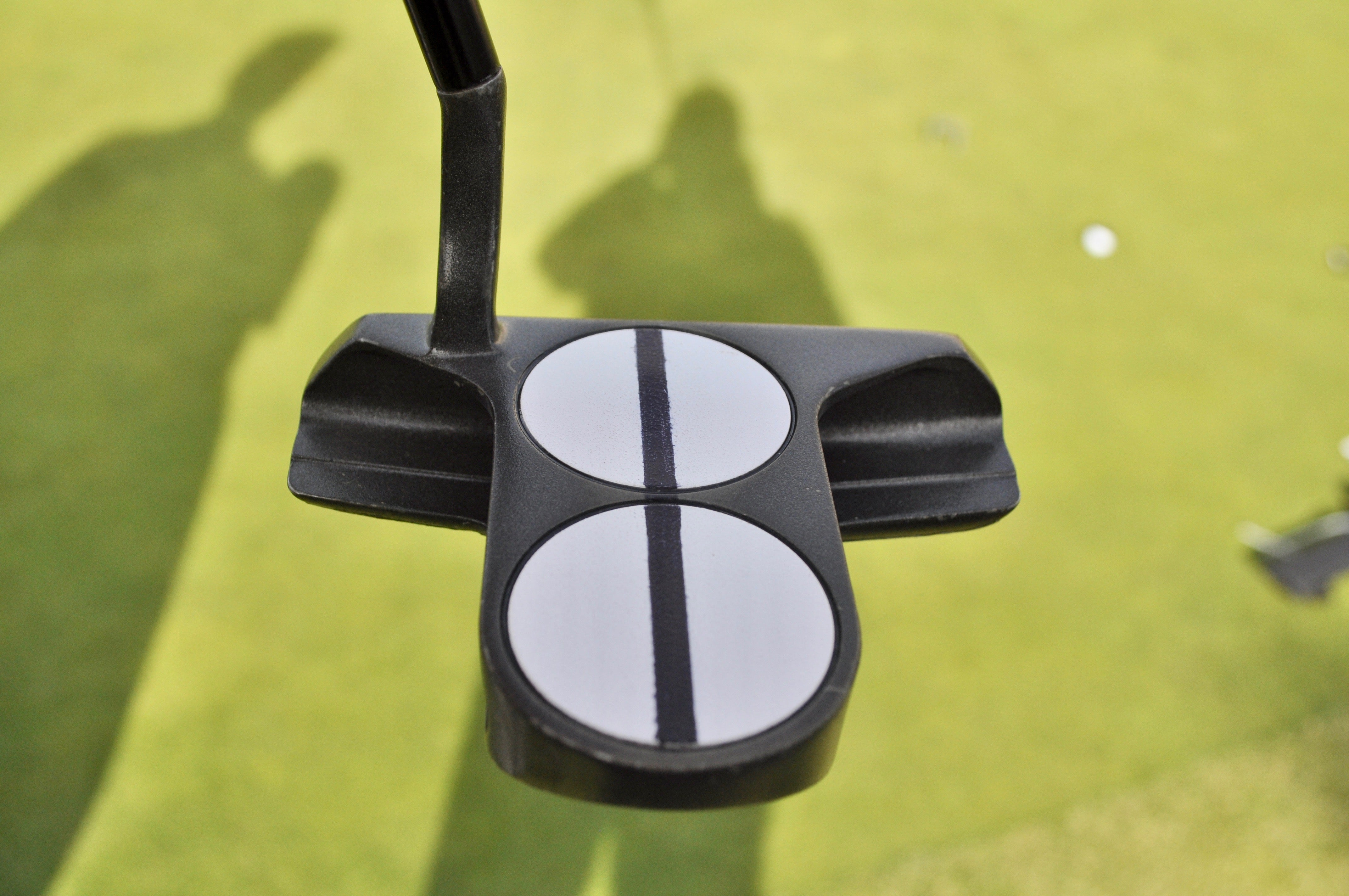 Tommy Fleetwood's caddie, Ian Finnis, used a black sharpie to add the alignment line to his Odyssey DFX 2-Ball putter.