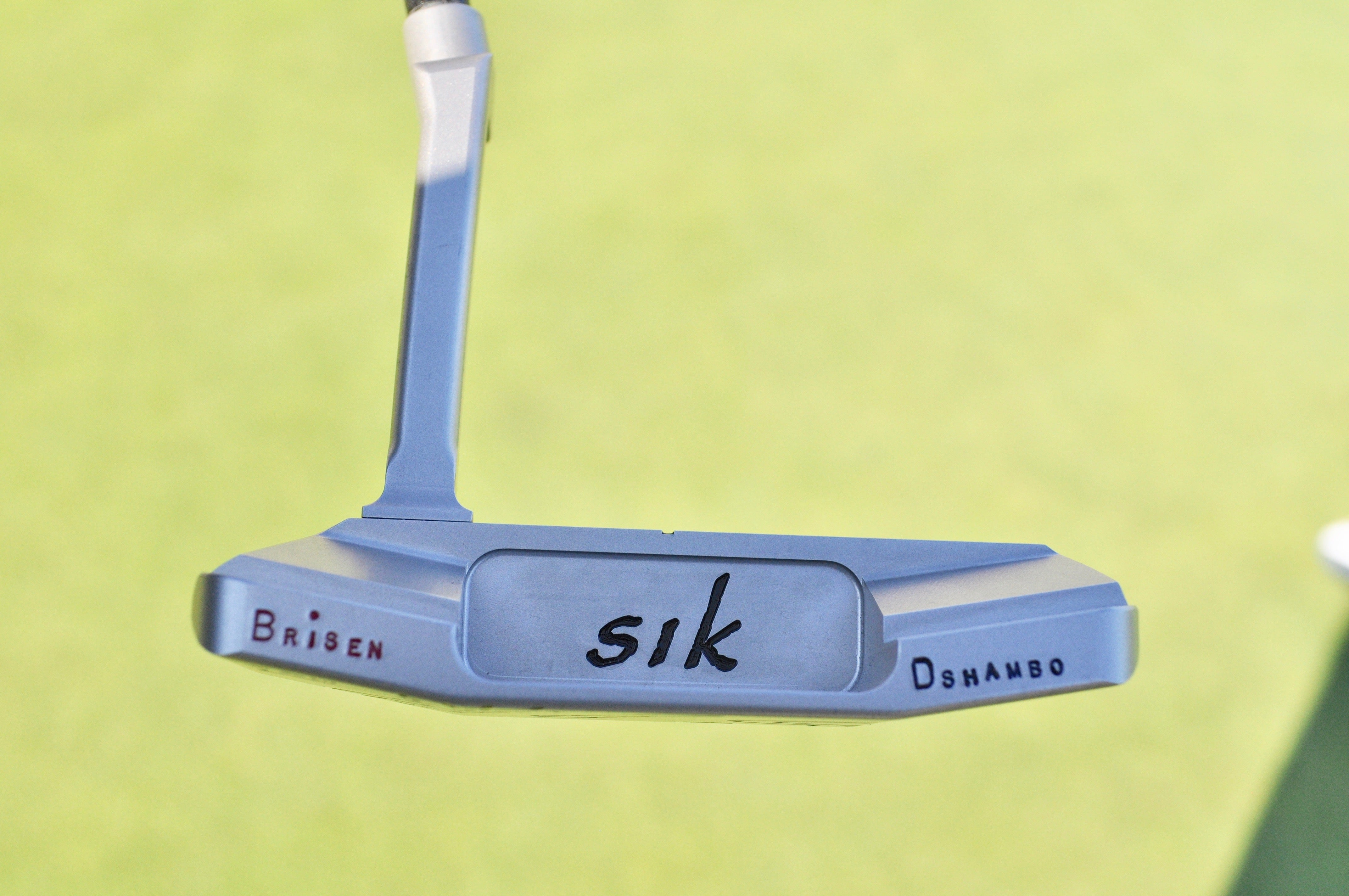 The phonetic spelling of Bryson DeChambeau's name is stamped on the bumpers of this Sik putter.