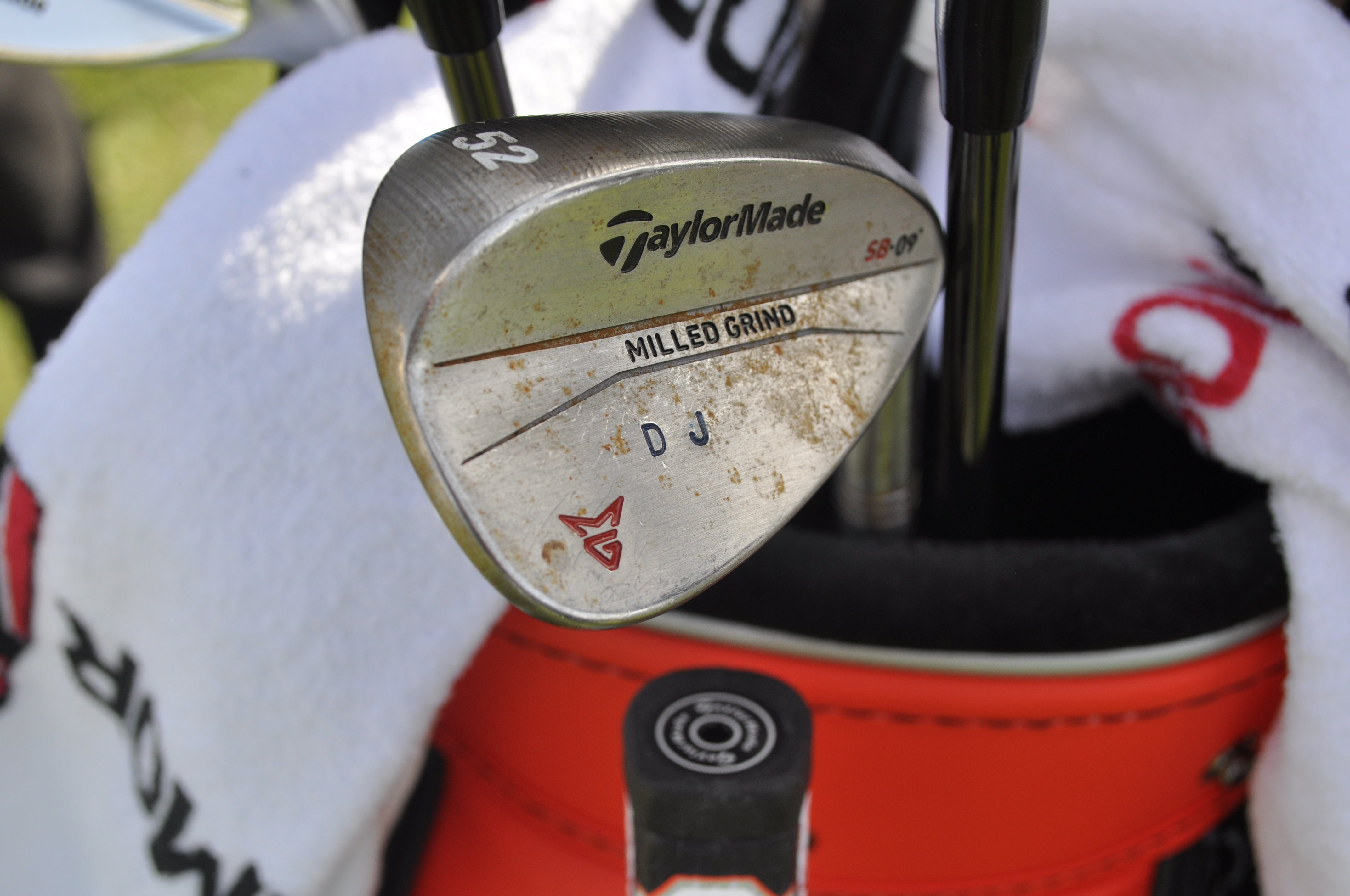 Dustin Johnson has his initials stamped on the head of his TaylorMade Milled Grind wedges.