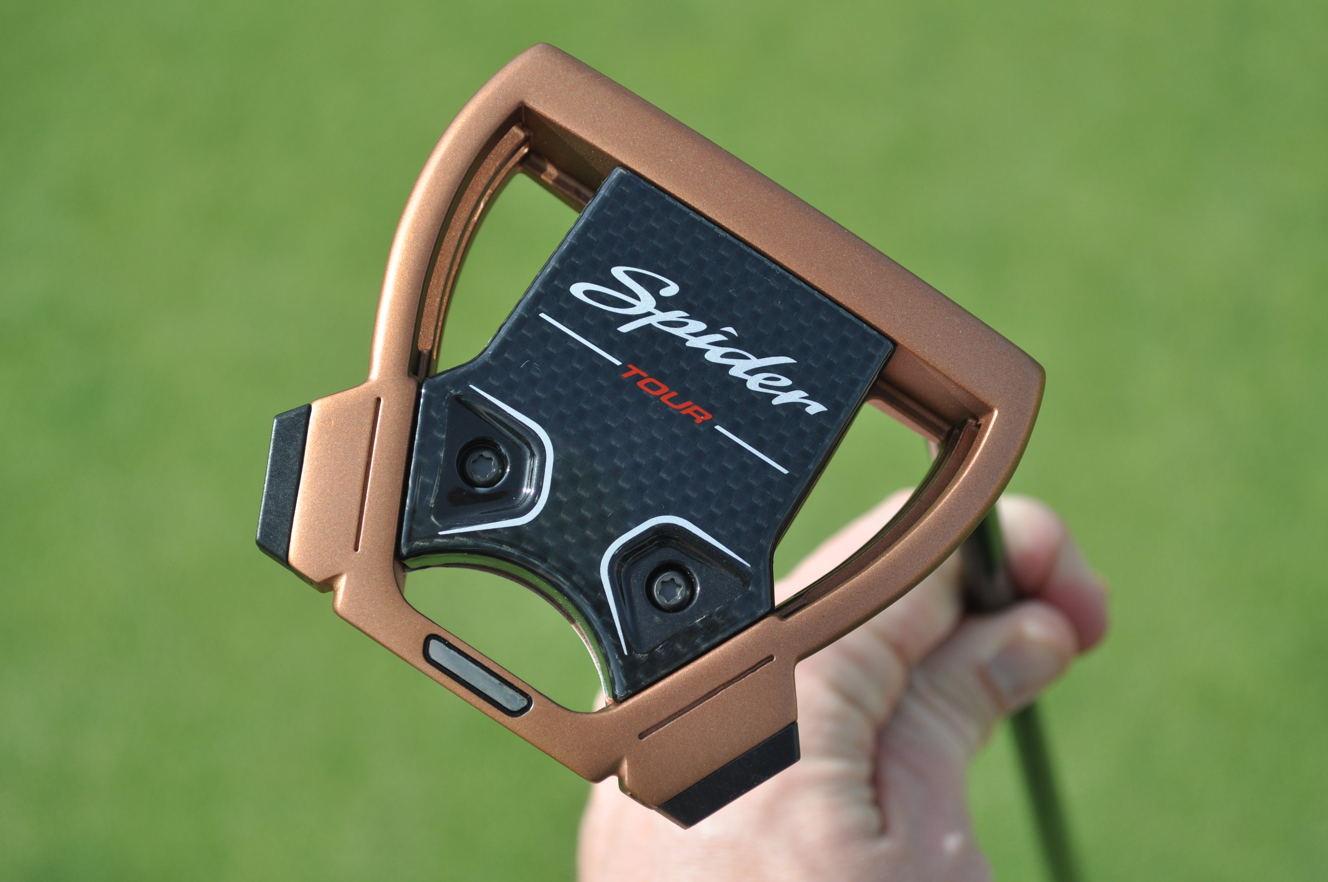 Dustin Johnson tested TaylorMade's new Spider Tour putter with a cross-handed grip on Tuesday.