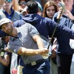 Dustin Johnson hits an approach during the final round of the WGC-Mexico Championship.