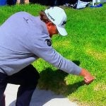 J.B. Holmes looks for his ball in the rough at Riviera Country Club.