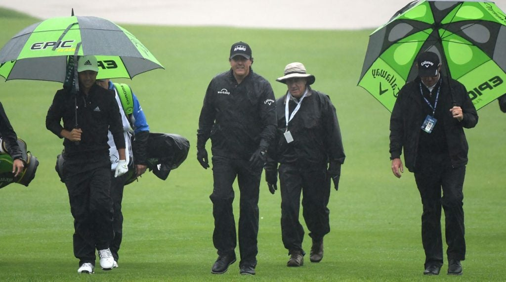 Phil Mickelson walks off the 10th hole after play was suspended on Thursday morning at the Genesis Open.