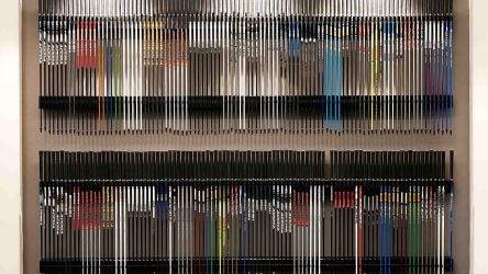 True Spec wall of golf shafts