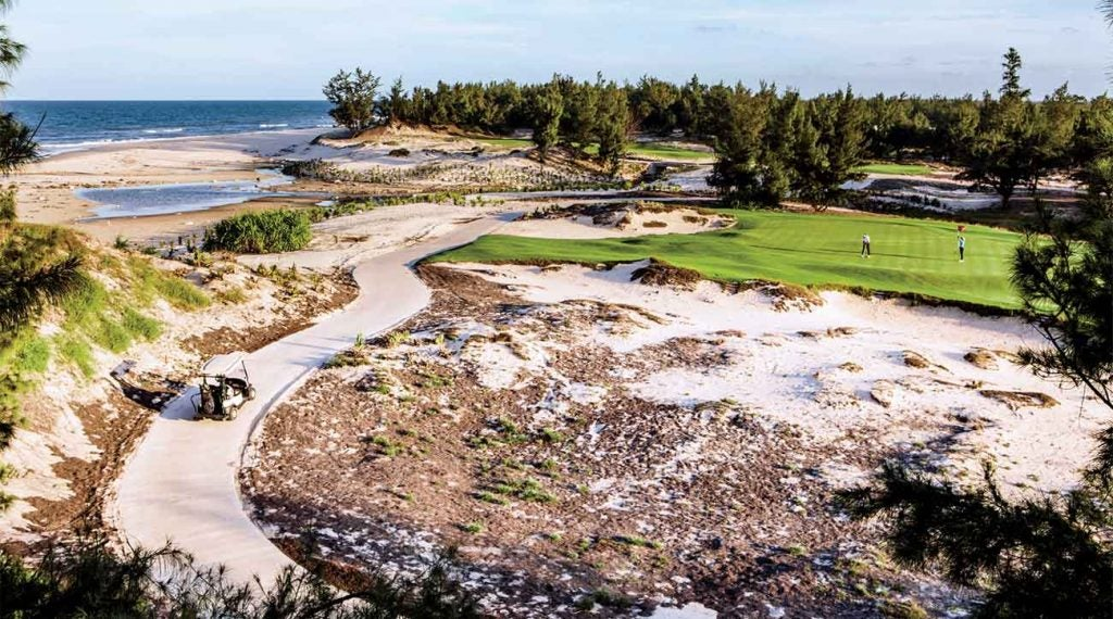 """The 15th on architect Brian Curley's sublime """"Course A"""" track, in Dong Hoi, runs up against the South China Sea—and has the sand to show for it."""