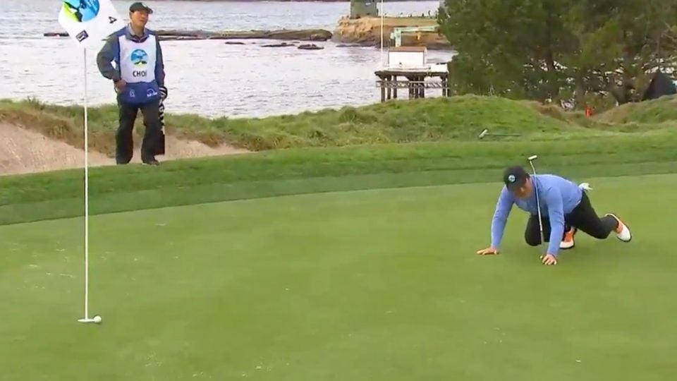 Hosung Choi crawls after his putt during the third round of the 2019 AT&T Pebble Beach Pro-Am