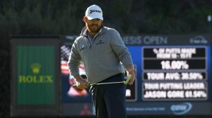 J.B. Holmes watches a putt on Sunday at Riviera.