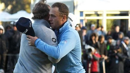 Justin Thomas congratulates J.B. Holmes for winning the Genesis on Sunday.
