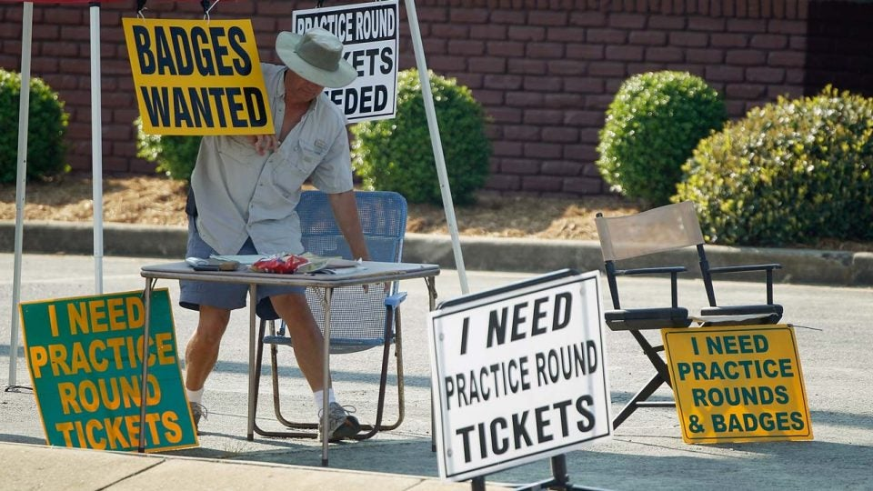 Tickets scalpers look for badges along Washington Road in front of Augusta National before the 2018 Masters