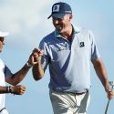 "David Giral Ortiz, known as ""El Tucan,"" and Matt Kuchar fist pump during the Mayakoba Golf Classic."