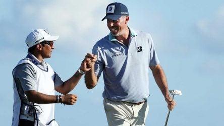 "David Giral Ortiz, known as ""El Tucan,"" and Matt Kuchar fist pump during the Mayakoba Golf Classic."