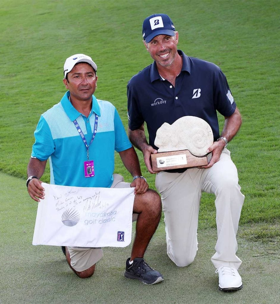 Kuchar and El Tucan pose with the winning trophy.