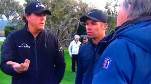 Phil Mickelson and Paul Casey talk with rules official Mark Russell.