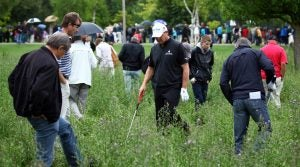 Paul Lawrie looks for his lost ball during the 2011 BMW International Open