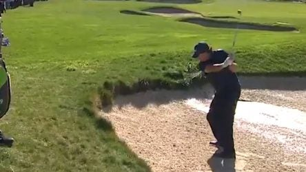 Phil Mickelson hits his wedge shot on the 4th hole at Pebble Beach on Saturday