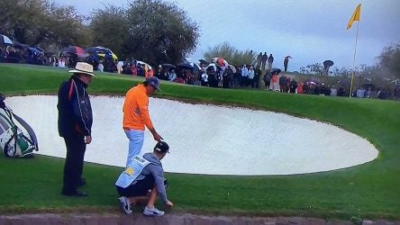 Rickie Fowler talks with rules official Slugger White during the final round of the Phoenix Open.
