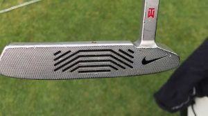 Tony Romo is using one of Tiger Woods' old Nike Method 001 putters.