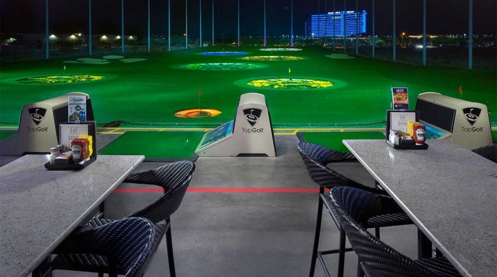A view of the hitting bays at Topgolf.