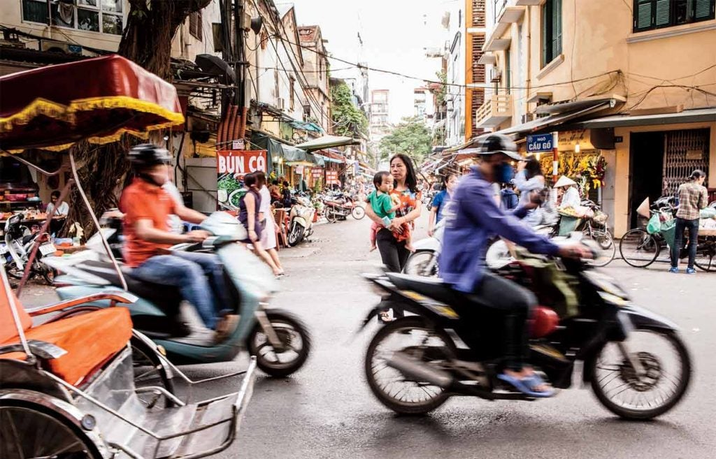 The Old Quarter in Hanoi screams with scooters and teems with energy.  Golf is a force in 'Nam, but the country's force of nature is its magnificent culture and people.