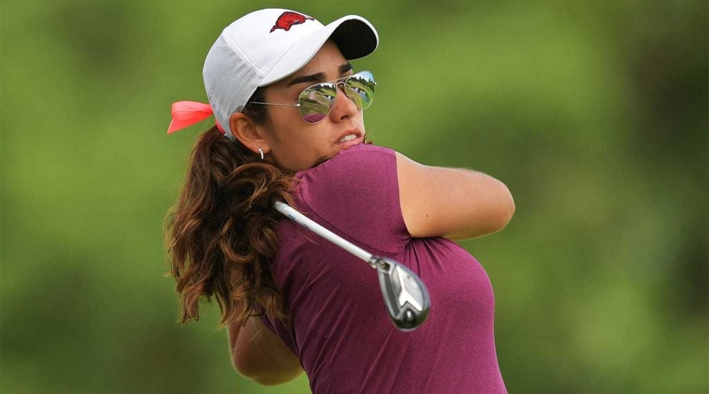 Maria Fassi watches a tee shot.