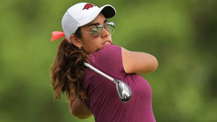 Maria Fassi watches a tee shot.