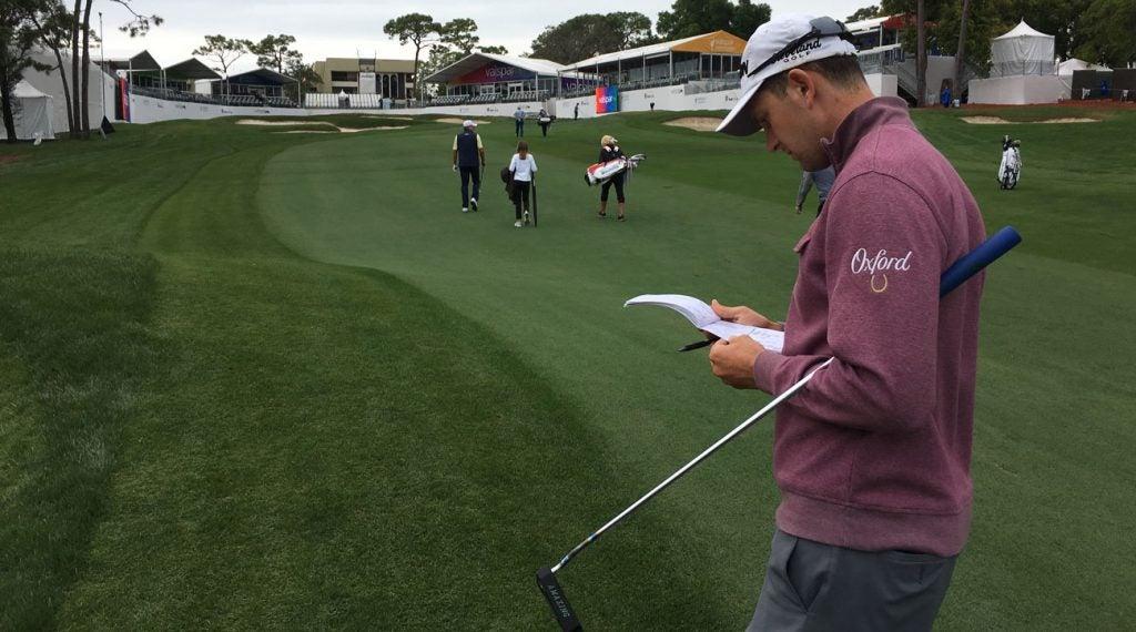 Martin Trainer consults his yardage book