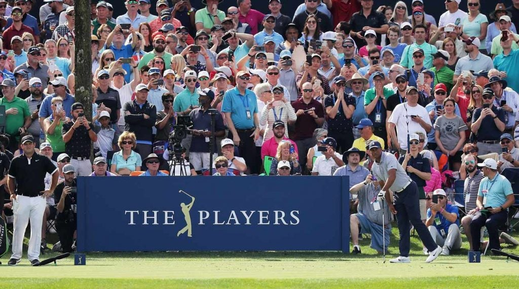 Playing with Tiger Woods means playing for a packed house. Patrick Reed likes that.