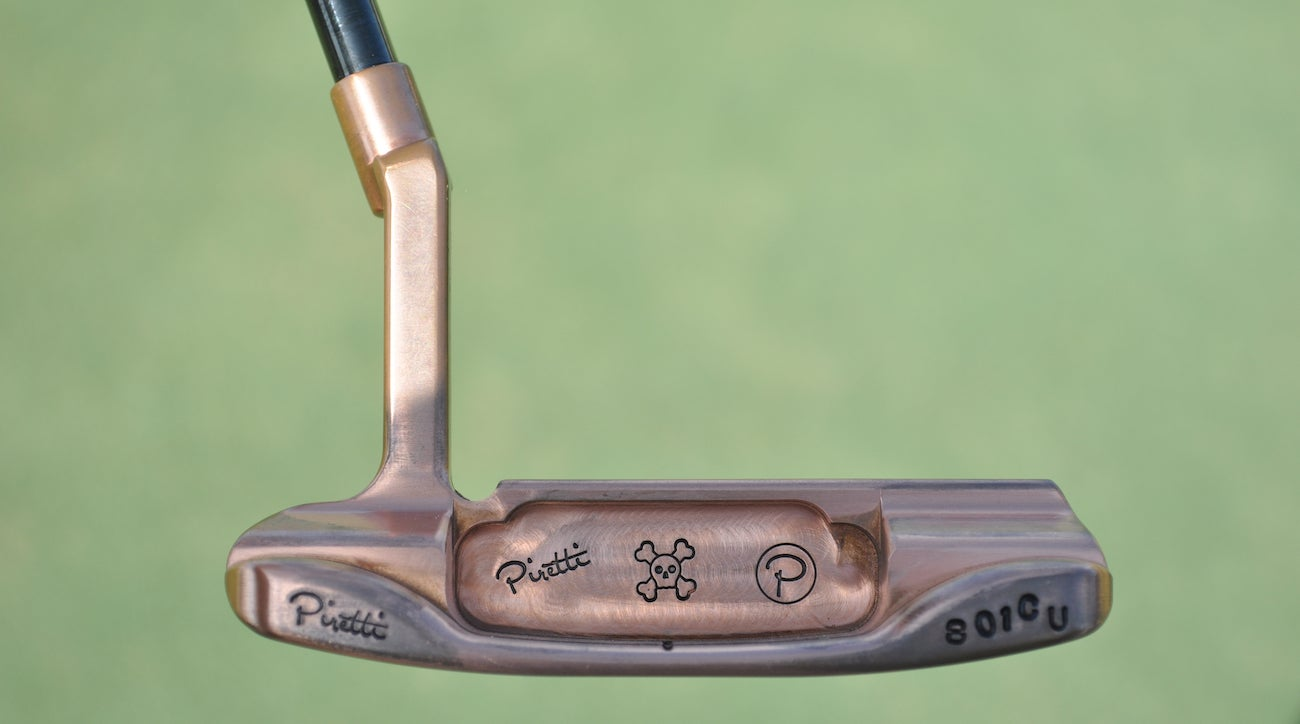 "The ""801CU"" stamped on the bumper of this Anser-style Piretti putter denotes the copper material used to create the head."