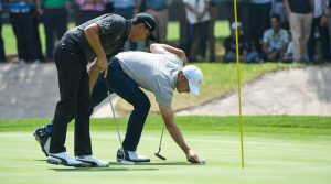 Rickie Fowler Jordan Spieth move a ball mark on green