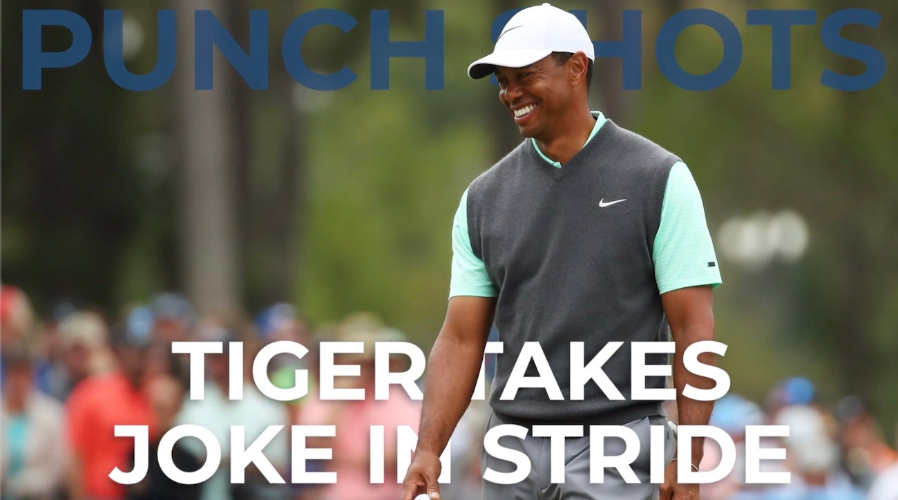 tiger gets a good laugh from a fan at the players championship