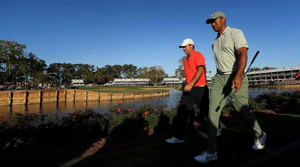 Tiger Woods and Patrick Reed walk down No. 17 together on Thursday.
