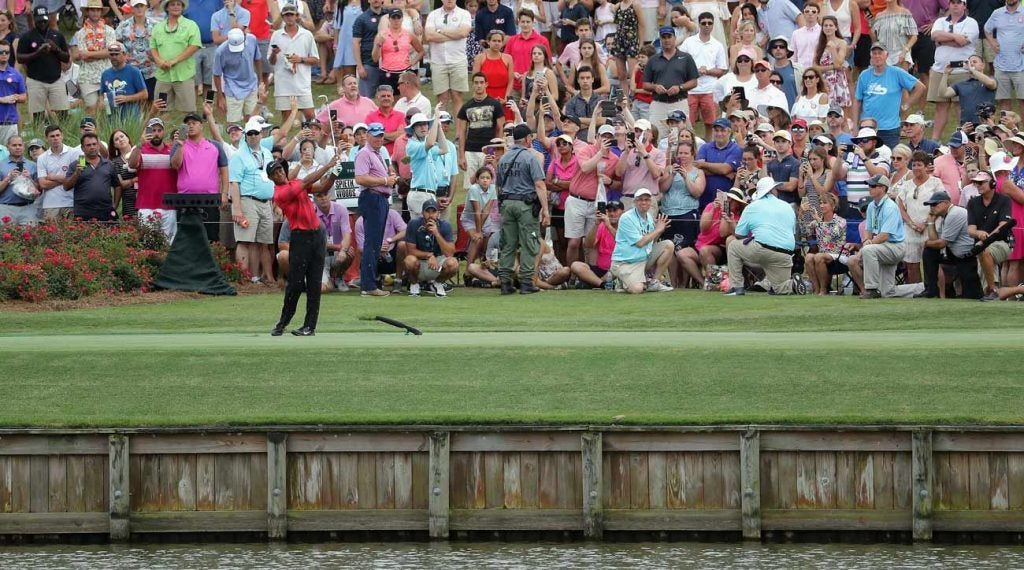 Last year, Tiger Woods hit wedge off No. 17 - and dumped it in the water.