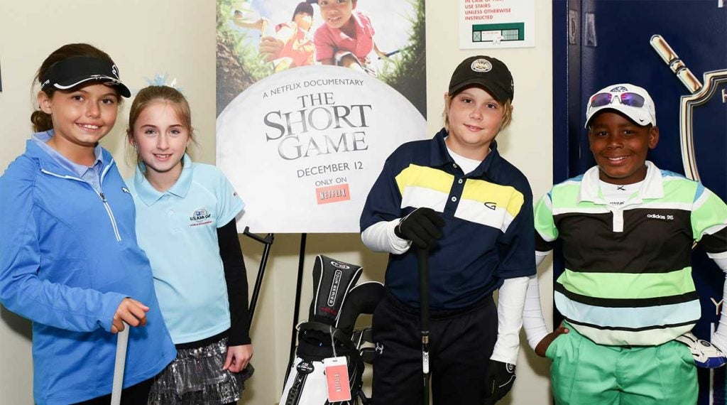 Alexa Pano (left) poses for a photo during a promotional event for The Short Game in December 2013 at Chelsea Piers in New York City.