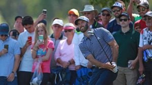 Dustin Johnson hits a wedge shot during the final round of the Valspar Championship.